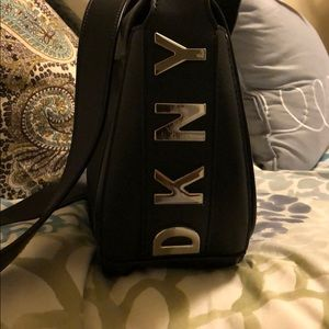 DKNYblack satchel bag.Includes unopened dustbag.